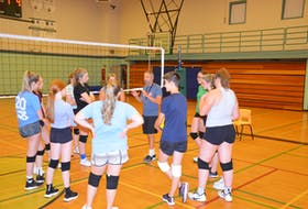 Kensington Intermediate-Senior High School (KISH) head coach Richard Younker discusses a drill with the senior AAA girls' volleyball team at a recent practice. The 46th edition of the KISH Volleyball Extravaganza is scheduled for this weekend. Play is to begin on Sept. 17 at 5 p.m., with the championship match set for Sept. 18 at 4 p.m.