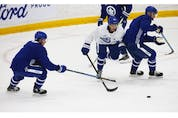 Toronto Maple Leafs forward Brett Seen (43) cuts past Mitch Marner (16) (left)  on the  ice at their practice facility in Etobicoke on Wednesday September 15, 2021. Jack Boland/Toronto Sun/Postmedia Network