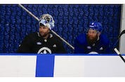 Toronto Maple Leafs goalie Jack Campbell on the bench with defenceman Justin Holl (8 - right)   at their practice facility in Etobicoke on Wednesday September 15, 2021. Jack Boland/Toronto Sun/Postmedia Network