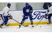 Toronto Maple Leafs forward Wayne Simmonds (24) caught in the middle  on the  ice at their practice facility in Etobicoke on Wednesday September 15, 2021. Jack Boland/Toronto Sun/Postmedia Network