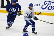 Toronto Maple Leafs defenceman Jake Muzzin (8)  with forward Rich Clune (39) on the  ice at their practice facility in Etobicoke on Wednesday September 15, 2021. Jack Boland/Toronto Sun/Postmedia Network