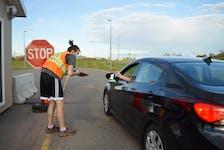 Ben MacIntosh screens a visitor to P.E.I. at the at the Confederation Bridge in Borden-Carleton. Guardian file