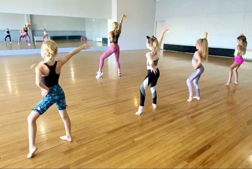 Elle Dance Academy co-owner Raechelle Fraser leads a troupe of young dancers as they practice in front of the big mirror at the new downtown Sydney dance academy. Fraser said her passion for dance is only rivalled by her love of teaching. CONTRIBUTED