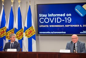 Nova Scotia Premier Tim Houston and Dr. Robert Strang, chief medical officer of health, hold a COVID-19 news briefing Wednesday in Halifax. During the briefing they announced plans to move into Phase 5 on Sept. 15. - Communications Nova Scotia