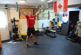 Steven Bishop works out at his Winsloe home. Bishop recently won a gold medal at the 2021 world masters weightlifting championships, which were held virtually.