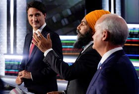 Liberal leader Justin Trudeau, left to right, NDP leader Jagmeet Singh, and Conservative leader Erin O'Toole take part in the federal election English-language leaders debate in Gatineau.
