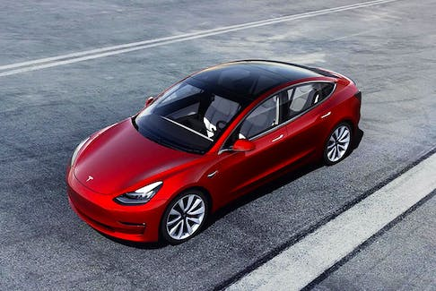 Tesla cars, like the Model 3 shown here, may some day feature laser beams instead of windshield wipers. Handout/Tesla