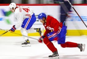 Rafael Harvey-Pinard (left) and Isiah Campbell take a fast lap around the rink at Bell Sports Complex in Brossard during Canadiens rookie camp Thursday.