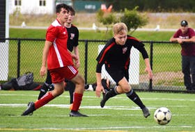 Blake Boutilier of the Glace Bay Panthers, right, blows past Lonsulu Nillux Jui of the Riverview Ravens during Cape Breton High School Soccer League boys' action at Open Hearth Park in Sydney, Thursday. JEREMY FRASER/CAPE BRETON POST