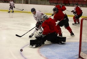 Valley Wildcats forward Ethan Kearney locates the puck after Truro Bearcats goalie Felix Anthony Ethier makes the stop on a shot from the blue-line during Maritime Junior Hockey League pre-season action Sept. 17 at the Kings Mutual Century Centre in Berwick.