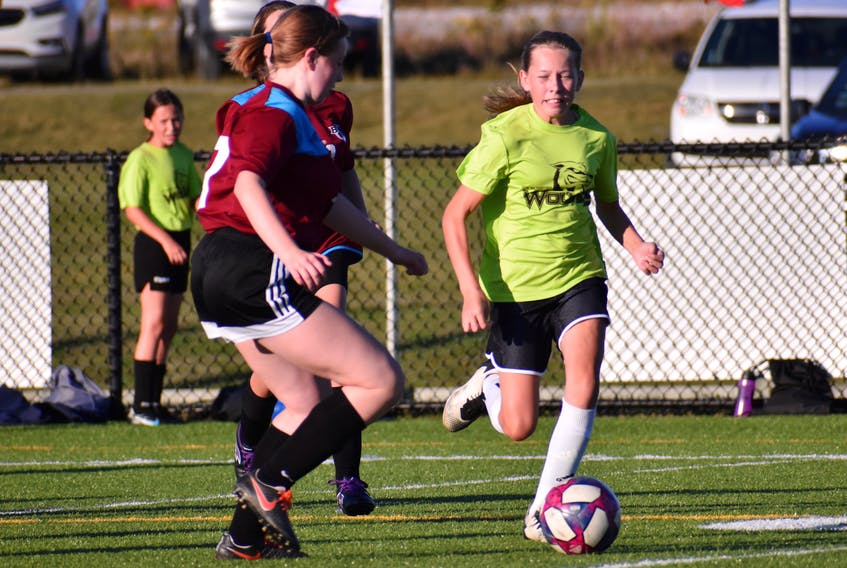 Anna Kaupp of the Breton Education Centre Bears, right, carries the ball as she's pressured by Julia MacDonald of Sherwood Park Education Centre during Cape Breton Middle School Soccer League girls' 'A' action at Open Hearth Park in Sydney, Friday. BEC won the game 6-1. JEREMY FRASER/CAPE BRETON POST.