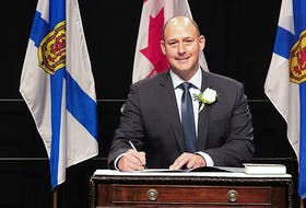 Dartmouth East MLA Tim Halman signs his oath of office after being sworn in as minister of environment and climate change in the Tim Houston-led Progressive Conservative government. -- Communications Nova Scotia