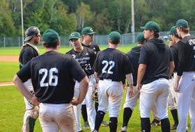 Avery Arsenault, 23, and his Charlottetown Gaudet's Auto Body Islanders huddle before Game 2 of the best-of-seven New Brunswick Senior Baseball League final series against the Moncton Fisher Cats at Memorial Field on Sept. 13. Arsenault scored the game-winning run in a 4-3 eight-inning win in Moncton, N.B., on Sept. 16. That victory gave the Islanders a 2-1 series lead. Game 4 goes at Memorial Field in Charlottetown on Sept. 17 at 7:30 p.m.