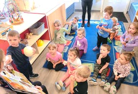 Logan Levangie, left, shows his classmates at Town Daycare in Glace Bay an ostrich egg. The three-year-olds were learning about birds. Listening intently are Alexis MacKinnon, Holly Younger, Owen O'Leary, Brielle MacIntosh, Scarlett Rideout, John-Thomas King, Miley Popwell, Ryan Doyle, A.J. Lockman, Lainey MacIntosh and William Coolen. CONTRIBUTED