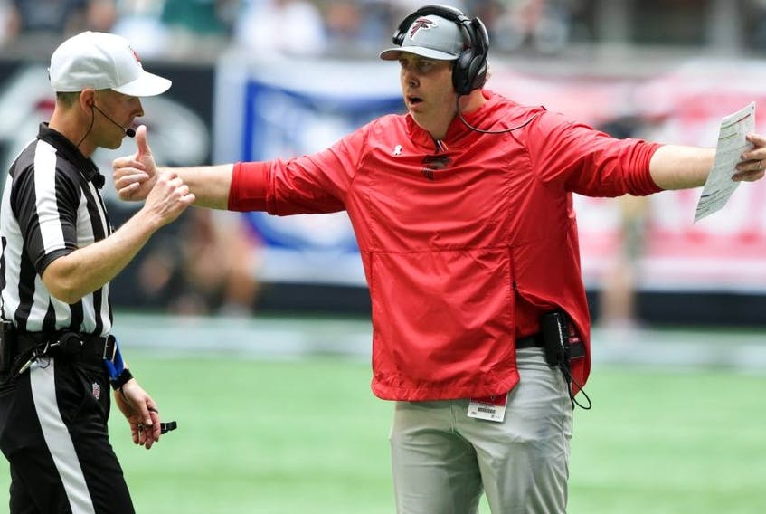 Atlanta Falcons head coach Arthur Smith talks with the referee against the Philadelphia Eagles during the first quarter at Mercedes-Benz Stadium. Officials have been specifically instructed this season to call offensive holding more or less on pre-2019 thresholds, league sources told Postmedia this week. USA TODAY