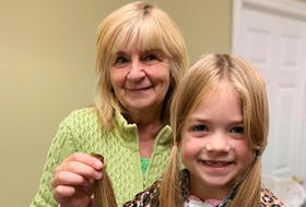 Barb Skinner with her granddaughter, Liviya Soulier, 7, who holds some locks of her hair after she had them cut to donate to Angel Hair for Kids, a charity that makes wigs for juvenile cancer patients. - Contributed