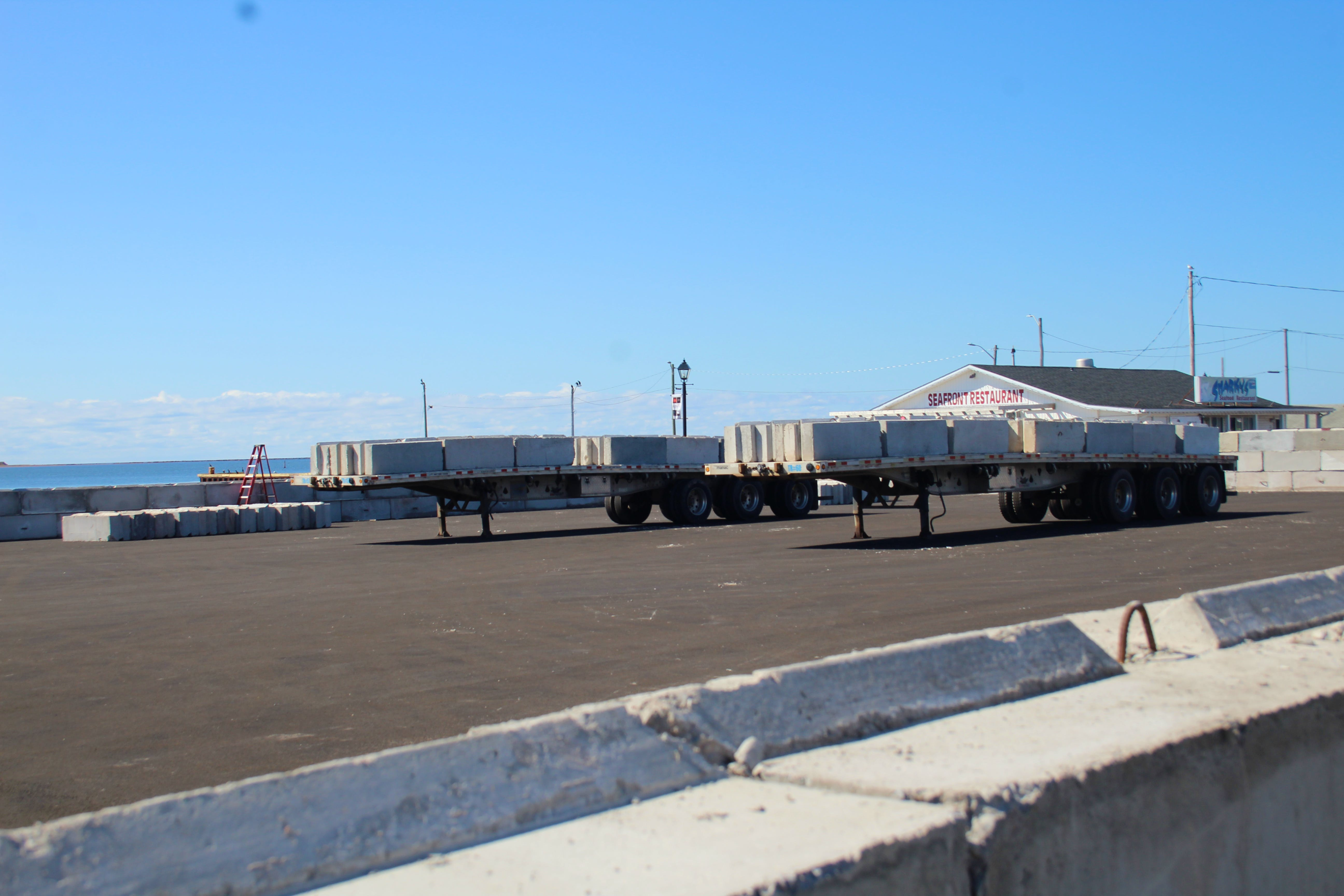 Summerside Port Corporation began removing the waterfront salt storage structure on Sept. 17. The blocks are being moved to a second location while the port works out a plan with the city.