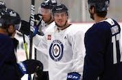 Nate Schmidt (left) looks up at Adam Lowry as some Winnipeg Jets veterans skated at Bell MTS Iceplex in west Winnipeg on Wed., Sept. 16, 2021. KEVIN KING/Winnipeg Sun/Postmedia Network