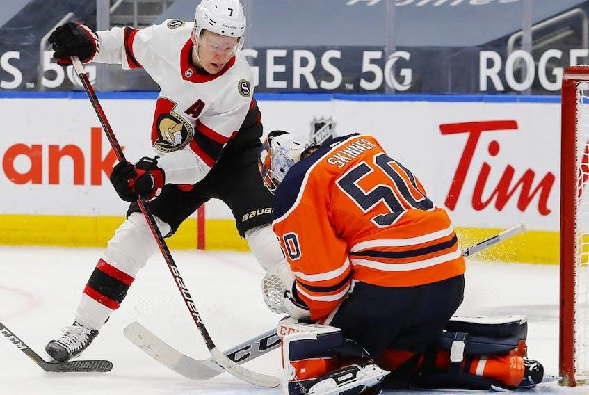 Edmonton Oilers goaltender Stuart Skinner (50) makes a save against Ottawa Senators forward Brady Tkachuk (7) during the second period at Rogers Place.