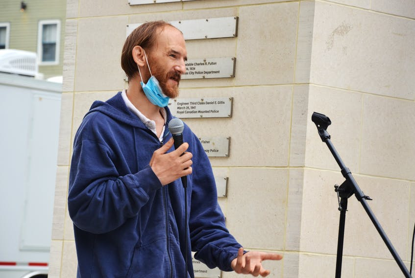 A man identified only as Malcolm speaks at a rally held Saturday at the Grand Parade in downtown Halifax to support a moratorium on the eviction of homeless people from tents and shelters in Halifax Regional Municipality.