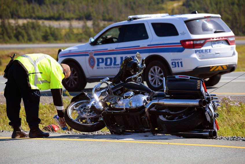 AN RNC officer marks the location of a motorcycle following a double-motorcycle crash on Peacekeepers Way Saturday afternoon. Keith Gosse/The Telegram