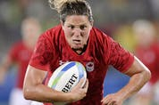 Canada's Kelly Russell scores a try against Great Britain at the 2016 Summer Olympics in Rio de Janeiro, Brazil on Aug. 18, 2016.
