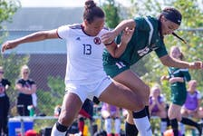Cape Breton's Alliyah Rowee, right, and UNB's Olivia Rowinski battle for the ball during an AUS women's soccer league game in Fredericton on Saturday. - UNB Athletics