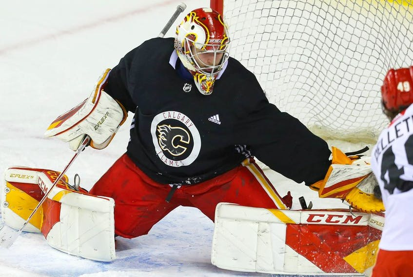 Goalie Dustin Wolf makes a save off Jakob Pelletier during the Calgary Flames prospects' camp in on Thursday, Sept. 16, 2021.