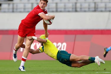 Philip Berna of Canada in action with Josh Coward of Australia at the Tokyo Olympics.