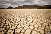 Clouds gather but produce no rain as cracks are seen in the dried up municipal dam in drought-stricken Graaff-Reinet, South Africa.