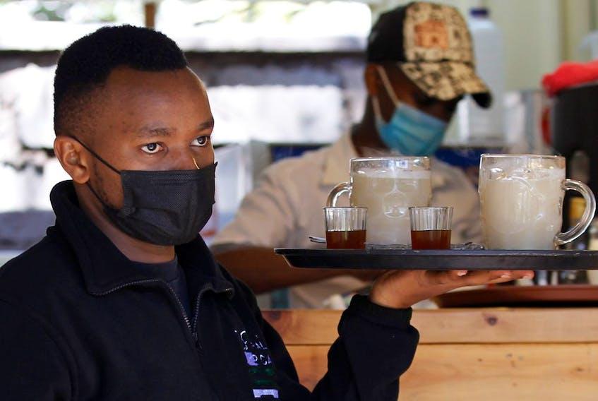 A server works inside a cafe in Nairobi, Kenya.
