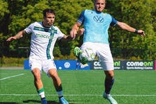 HFX Wanderers FC defender Peter Schaale, right, tries to keep the ball away from a York United attacker during Saturday's Canadian Premier League game at York Lions Stadium.