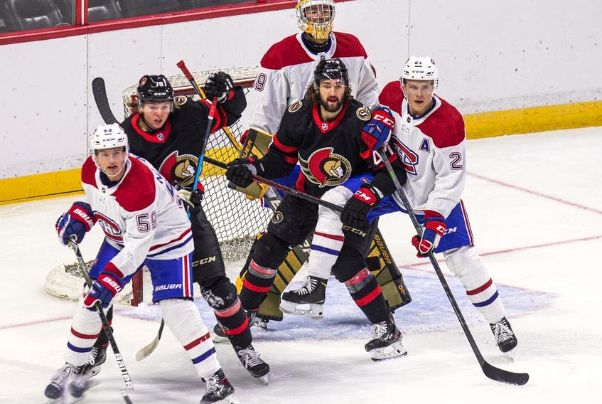 There's a lot of traffic in front of Canadiens netminder Joe Vrbetic during the first period of the game against the Senators. Those in front include Montreal's Mattias Norlander (59) and Kaiden Guhle (21) and Ottawa's Carson Latimer (78) and Mark Kastelic (47).