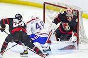Senators goalie Mads Sogaard makes a save in the first period as defenceman Jacob Bernard-Docker checks Montreal's Rafael Harvey-Pinard.