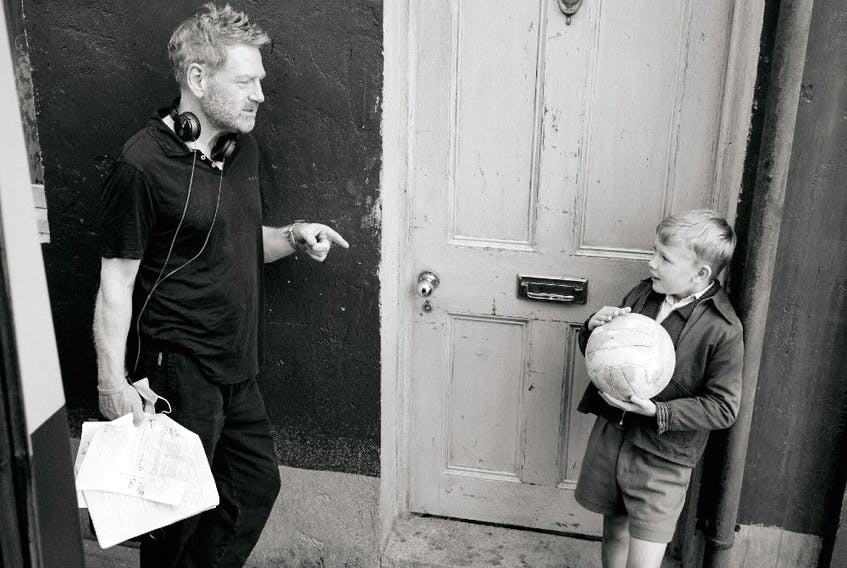 Kenneth Branagh and Jude Hill on the set of Belfast.