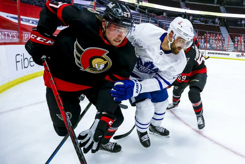 Logan Brown battles along the boards against the Leafs' Nick Foligno during the Senators game in Ottawa on May 12.
