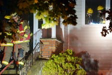 A house was extensively damaged during an early morning house fire in St. John's Sunday. Keith Gosse/The Telegram