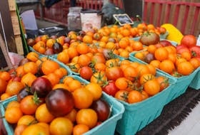Tomatoes from Thyme for Ewe farm sit on a cart outside the Food Hub's store on opening day. JESSICA SMITH/CAPE BRETON POST