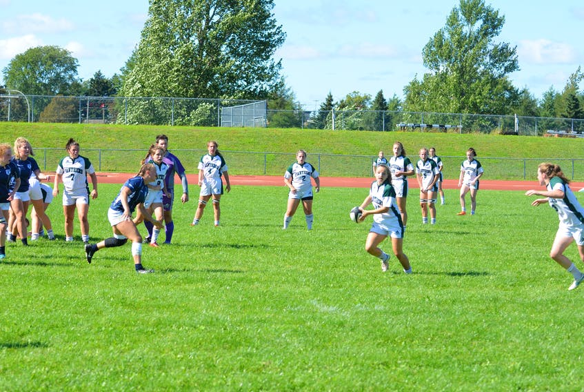 The UPEI Panthers' Maddy Clements makes a pass during the team's Atlantic University sport women's rugby season and home opener against the St. Francis Xavier X-Women in Charlottetown on Sept. 11. Clements scored the Panthers' lone try in a 22-5 loss to the host Acadia Axewomen on Sept. 18.