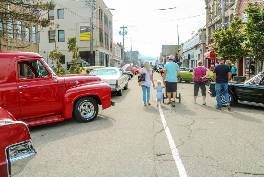 Attendees look at the array of antique vehicles on display at the fifth annual Fall Classic car show, on Charlotte Street in Sydney on Saturday afternoon. The show, hosted by the Cape Breton Classic Cruisers car club, took over the main thoroughfare between 11 a.m. and 5 p.m., giving the public the opportunity to see dozens of the island's finest classic and custom motor vehicles. JESSICA SMITH/CAPE BRETON POST
