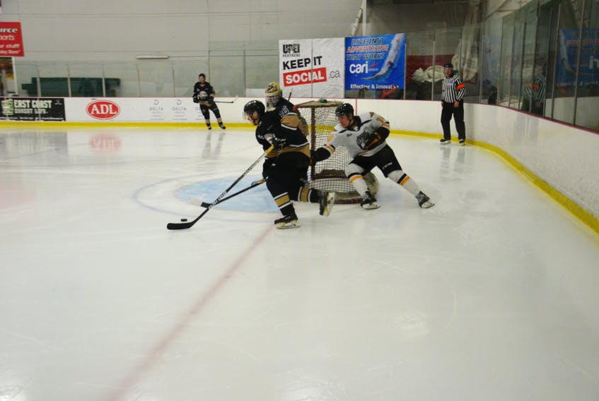 Charlottetown Islanders defenceman Isaac Vos, 16, carries the puck out of the defensive zone while being pursued by the Cape Breton Eagles' Lucas Canning during a Quebec Major Junior Hockey League pre-season game on Sept. 18. Vos scored one of the Islanders' goals in a 4-2 loss at MacLauchlan Arena in Charlottetown.