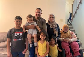 The Al Masri family said communicating with the school was a challenge before receiving help from the YMCA. From left to right (top): Aktham, Elias, Mohammad, Fatema, and Nour. From left to right (bottom): Salsabeel and Rital.