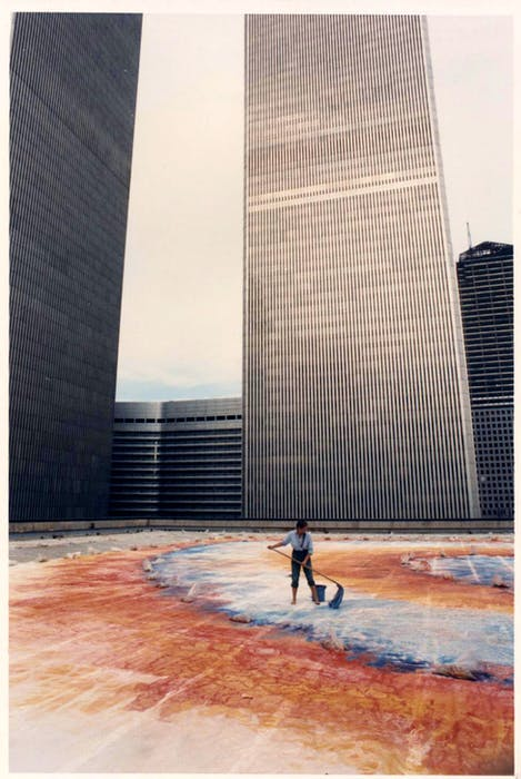 A 1984 photo shows Joanna Gilman Hyde painting her giant mural Self-Organizing Galaxy at the base of New York City's twin towers at the World Trade Center. - Saltwire network
