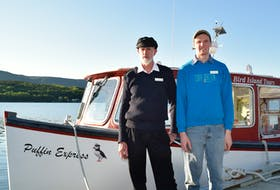 Capt. Vince Van Schaick, left, co-owner of Bird Island Boat Tours in Big Bras d'Or, and his son Capt. Ian Van Schaick, in front of their boat called the Puffin Express, in roughly 2018. Picture courtesy of Bird Island Boat Tours