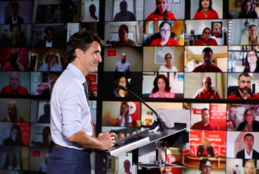 Canada's Liberal Prime Minister Justin Trudeau looks on as he delivers a speech at the Metro Toronto Convention Centre during his election campaign tour in Toronto, Ontario, Canada, September 1, 2021.