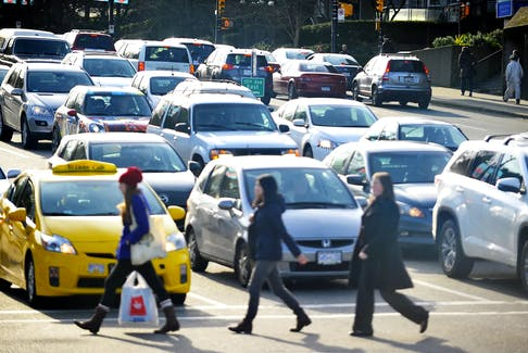 Traffic and people congestion clogs the intersection of West Broadway and Cambie in Vancouver in this 2015 file photo. Wayne Leidenfrost/Postmedia News file