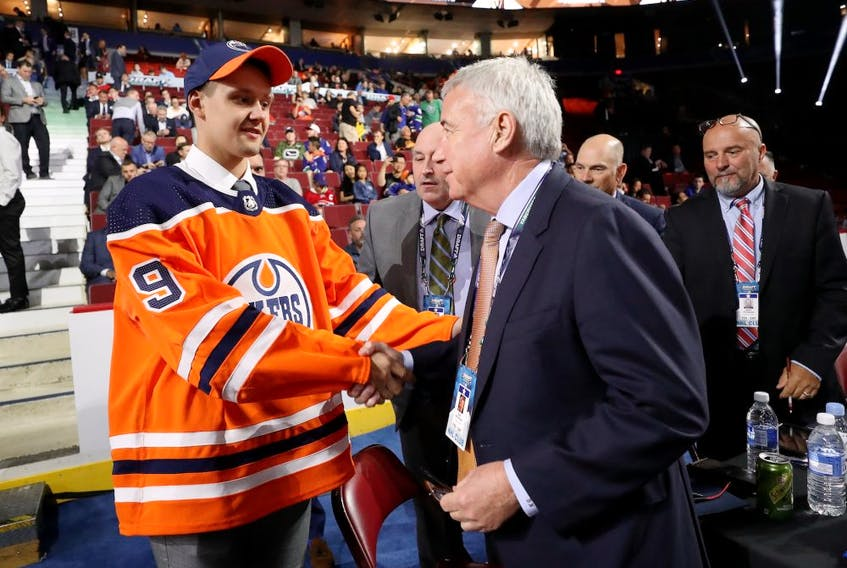 Ilya Konovalov shakes hands with Oilers CEO Bob Nicholson being selected 85th overall by the Edmonton Oilers during the 2019 NHL Draft at Rogers Arena on June 22, 2019.