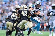 Carolina Panthers running back Christian McCaffrey breaks free for a touchdown as New Orleans Saints strong safety Malcolm Jenkins (27) and free safety Marcus Williams (43) defend in the fourth quarter at Bank of America Stadium. (Bob Donnan/USA TODAY Sports)