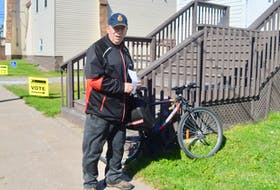 Whitney Pier resident Allan MacDonald cycled his way from his home on East Broadway to the federal election polling station at the St. Alban's Anglican Church Hall in the electoral district of Sydney-Victoria. MacDonald's outing quickly turned into a social event of sorts as he spent considerable time chatting with friends outside the polling station which experienced a steady parade of voters throughout the morning.