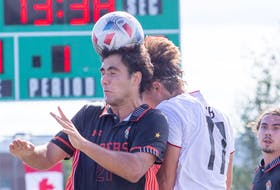 Cape Breton's Jose Maria Ribeiro de Cunha, left, and New Brunswick's Luke Rosettani challenge for the ball during Atlantic University Sport men's soccer action at Willie O'Ree Place Complex in Fredericton on Saturday. New Brunswick won the game 4-2. PHOTO CONTRIBUTED/JAMES WEST, UNB ATHLETICS